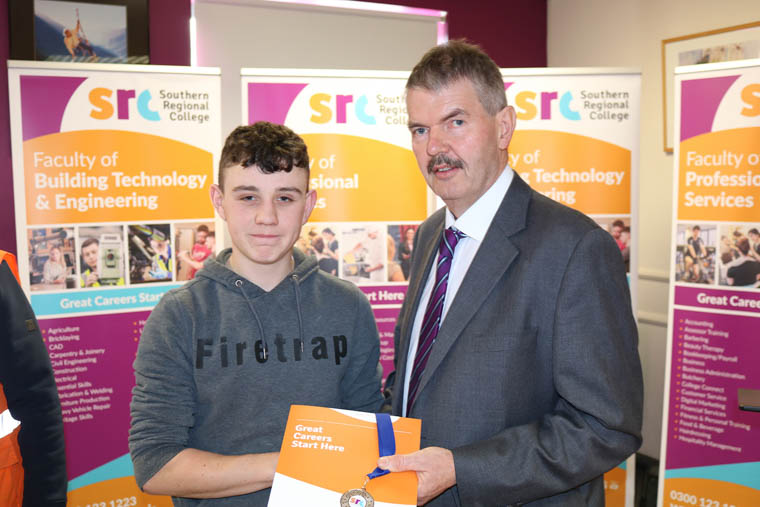 St Paul's Bessbrook pupil Conor O'Rourke took Silver in Plastering with John Muckian Deputy Head of Construction SRC
