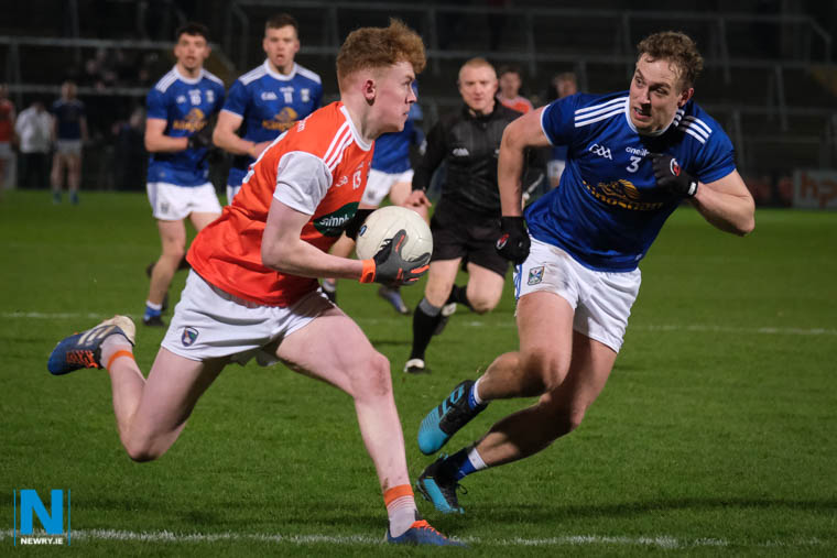 Armagh's Conor Turbitt in full stride breaking past Cavan's Padraig Faulkner at the Athletic Grounds. Conor scored a total of 1:6. Photograph: Columba O'Hare/ Newry.ie