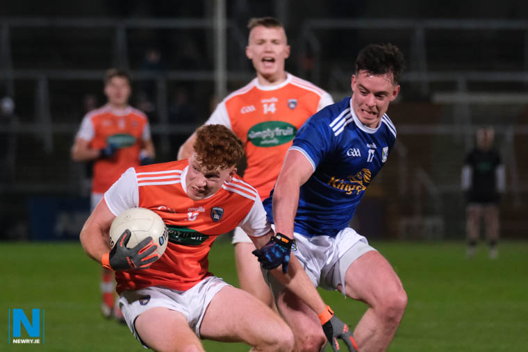 Armagh's Jason Duffy is tackled by Cavan's Gerard Smith at the league opener in Armagh. Photograph: Columba O'Hare/ Newry.ie