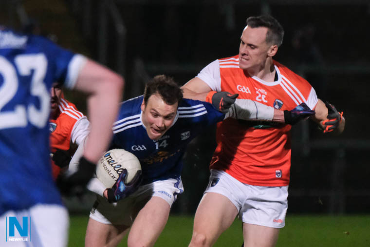 Armagh's Mark Shields closes in on Cavan's Gearoid McKiernan at the Athletic Grounds. Photograph: Columba O'Hare/ Newry.ie