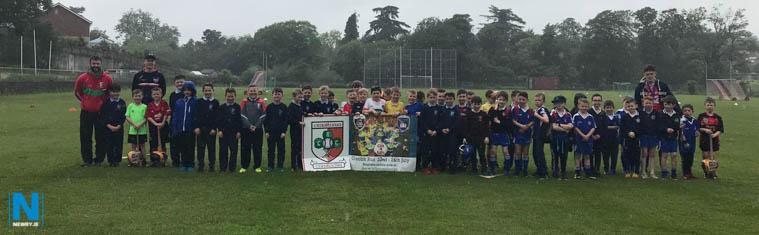 Craobh Rua Coaches with young Primary 4 Hurlers at the recent club