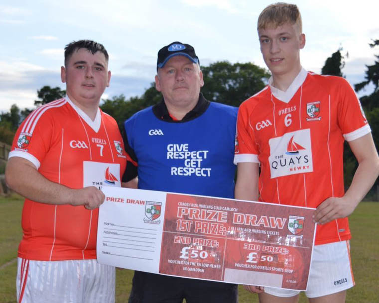 Senior Hurling Team Manager Brian Murphy with Nathan O Shea & Tiarnan O Hare at the launch of this years annual All Ireland Hurling Final Tickets Draw