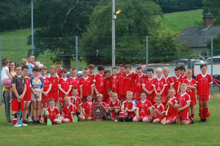 Members of the Hughes family pictured with some of the young Craobh Rua Hurlers who participated in the recent Richard Hughes Memorial Underage Hurling Blitz