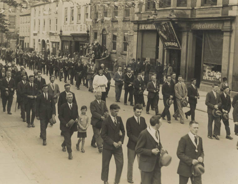 A Corpus Christie procession passing the Frontier Cinema in John Mitchel Place c.1934 Newry and Mourne Museum Collection