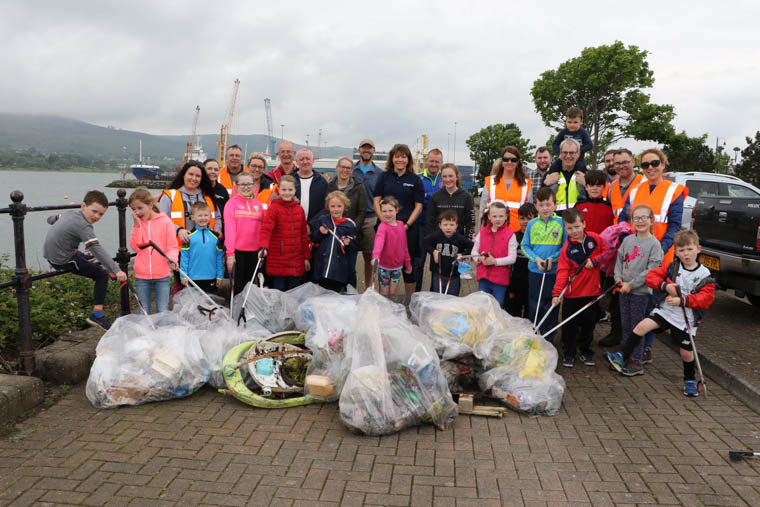 Volunteers from Warrenpoint Port who took part in a clean up along the coastline of Carlingford Lough at the weekend, along with customers, their family and friends.