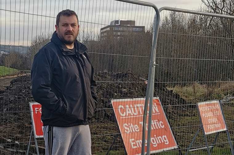 Stephen Murney check out the new pathway improvement work underway at Derrybeg.
