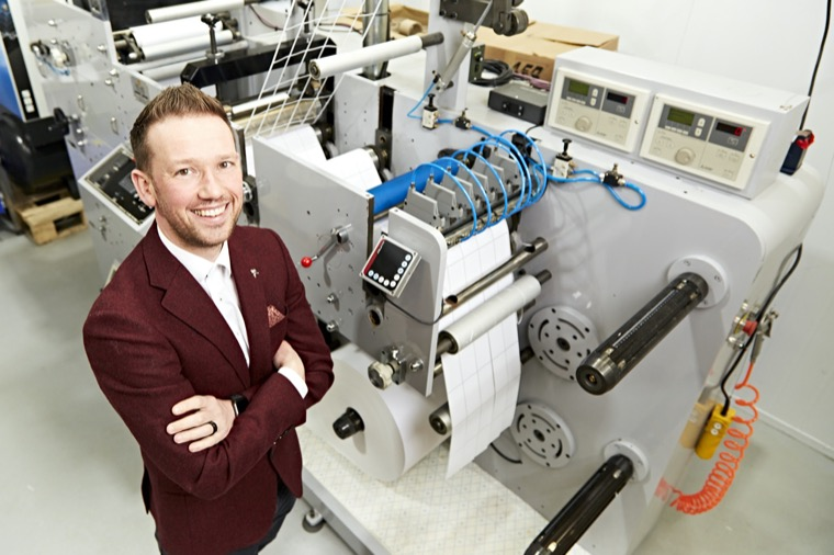 Gareth Chambers, CEO of Around Noon, at the new printing press in Newry