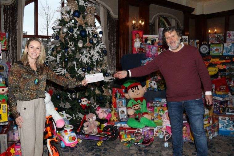 Newry, Mourne and Down District Council Chairperson, Councillor Laura Devlin presents Chairman of Newry Business Christmas Charity, Declan McChesney with a donation of £500 towards its Toy Mountain appeal. All the toys will be distributed to children in need in the area with the help of The Salvation Army and St. Vincent DePaul.