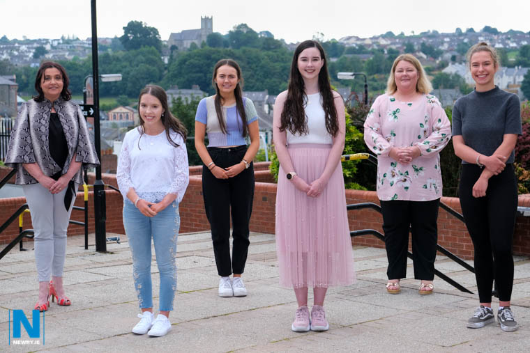 Our Lady's Grammar School Principal, Fiona McAlinden and Head of Sixth Form Sinead McLaughlin with students from left: Grainne Sweeney, Claire O'Keefe, Fionnuala McKeown and Paulina Chojnacka. The four students each achieved four or more A Grades at A Level. Photograph: Columba O'Hare/ Newry.ie