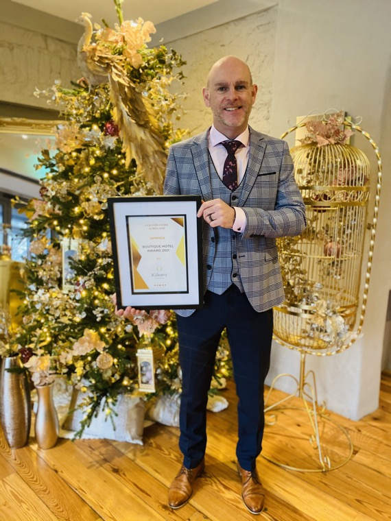 Jason Foody, General Manager of Killeavy Castle Estate with their award.