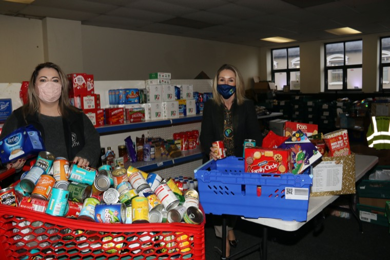 Newry, Mourne and Down District Council Chairperson, Councillor Laura Devlin helps Newry Food Bank Manager, Stella Maguire pack up one of many food boxes for families in the area.