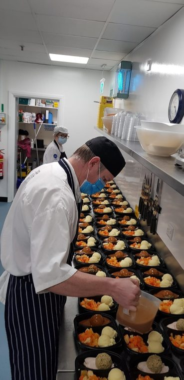Norbrook Laboratories Ltd Stephen Brothers preparing meals for the community