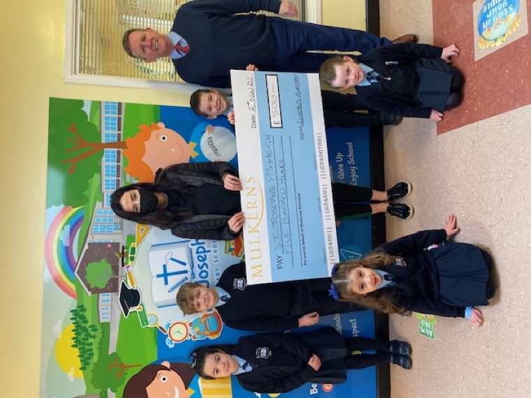 Kelly McKeown presents the 2nd Cash for Schools Prize of £500 to Gary Trainor, Principal St Joseph's Meigh & some pupils.