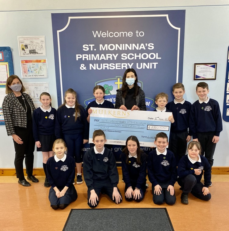 Kelly McKeown presents Runners Up Prize of £250 to Principal of St Moninna's PS Cloughoge & some pupils from P7.
