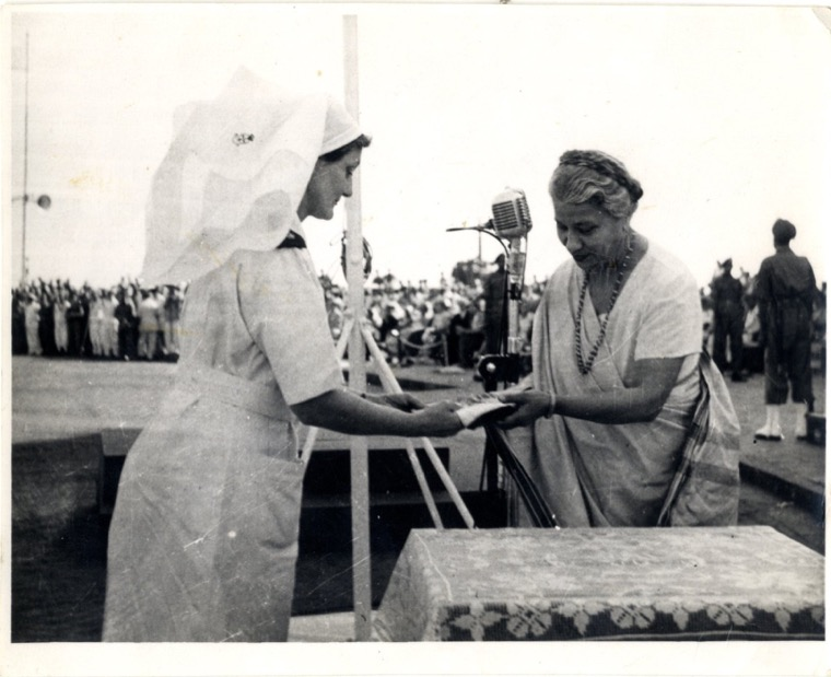 Photograph taken by Patricia Mahood while serving in India as a nurse. Written on reverse is 'Miss Johnson receiving the Indian National flag for the Q.A.I.M.N.S. (Queen Alexandra's Imperial Nursing Service) from her Excellency the Rani Maharaj Singh the Governor of Bombay's wife'. Newry and Mourne Museum Collection