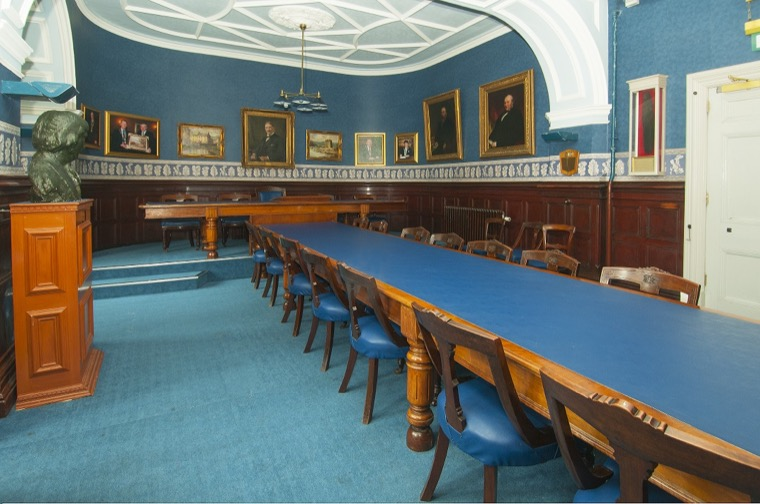 The Board Room in Newry Town Hall where the Town Commissioners met before they were dissolved. The furniture dates from this period and each chair is carved with the letters 'NTC' (Newry Town Commissioners).  Newry and Mourne Museum Collection