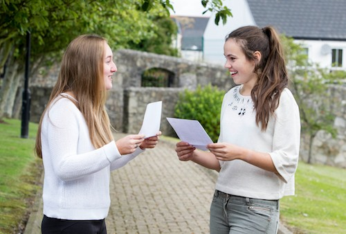 Our Lady's Grammar School Students Shannon McAteer and  Ellen Brown celebrate both  getting  10 A*'s   in there exam results. Photograph : Newraypics.com
