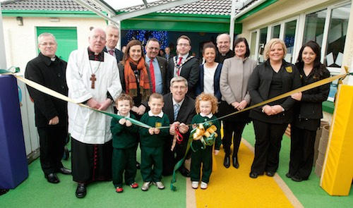 Education Minister John O'Dowd cuts the ribbon to open the new outdoor play area at St Patrick's Primary School, Nursery, Newry