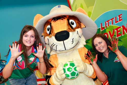 Caiomhe O Hagan, Michaela Foundation volunteer with Roary the Tiger and Sabrina McKeever, Manager South Armagh Childcare Consortium.