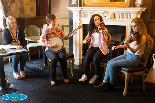 The music in full swing at the launch of Iúr Cinn Fleadh - Newry City Music Festival in Bellinis. Naomi Bailie, Chairperson, Newry, Mourne and Down Council listens intently to Marian McGauley, Iúr Cinn Fleadh Committee; Caoimhe McKivergan and Maria McGauley. Photograph: Columba O'Hare