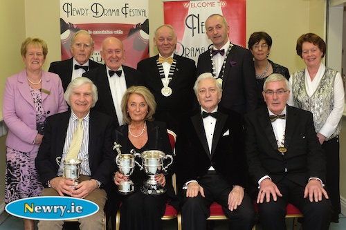 Terry Stewart and Carol Stewart, Holywood Players with their trophies for their play A month in the country at Newry Drama Festival. Also included front is Scott Marshall, Adjudicator and Gerry McNulty, Chairman, Newry Drama Festival. Back: Back: Eileen Mooney, Hon Secretary, NDF; Art Magennis, Vice Chairman; Charlie Smyth, President, NDF; Mac Pollock, Chairman, AUDF; Brendan McGowan, Chairman, ADCI; Christine Farrelly, Hon Treasurer, NDF and Maureen Grant, Press Officer, NDF. Photograph: Columba O'Hare
