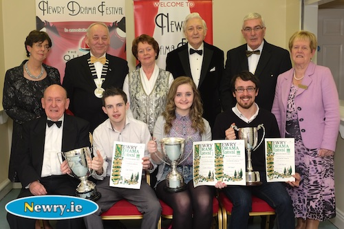 Neil Heaney, Niamh Smyth Hagan and Kilian Foy, Newport Players with their trophies for their production of Metamorphosis at Newry Drama Festival. Also included are, front, Charlie Smyth, President, Newry Drama Festival. Back: Christine Farrelly, Hon Treasurer, NDF; MacPollock, Chairman, AUDF; Maureen Grant, Publicity Officer, NDF; Scott Marshall, Adjudicator; Gerry McNulty, Chairman, NDF and Eileen Mooney, Hon Secretary, NDF. Photograph: Columba O'Hare