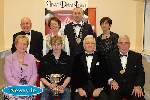 Andrew McCarthy, Ballyduff  Drama Group, Takin over the Asylum with the Gerard Murphy Cup for Best Music and Sound pictured with, back: Charlie Smyth, President, Newry Drama Festival; Maureen Grant, Publicity Officer; Brendan McGowan, Chairman, ADCI and Christine Farrelly, Hon Treasurer, Newry Drama Festival. Front: Eileen Mooney, Hon Secretary; Scott Marshall, Adjudicator and Gerry McNulty, Chairman. Photograph: Columba O'Hare