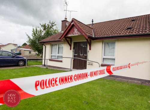 Police seal off the scene in Bessbrook in August. Photograph: NewRayPics