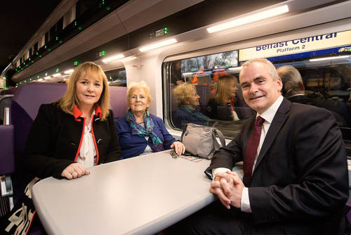 Regional Development Minister Michelle McIlveen and Chris Conway, Group Chief Executive for Translink are pictured chatting with customer Edna Murray from Belfast as the newly refurbished train left Belfast Central Station