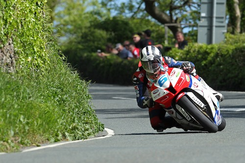Michael Dunlop (MD Racing) on his way to victory in the Isle of Man TT Supersport Race yesterday to make it four in a row. Photograph: Dave Kneen/ Pacemaker