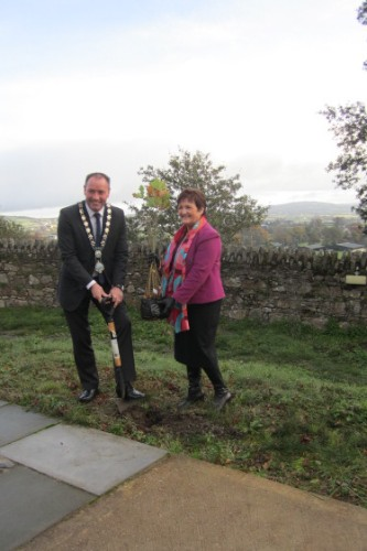 Mayor Michael Ruane and Clr Geraldine Donnelly get some practice in for the tree planting day at the Flagstaff.