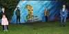 Pictured at the unveiling of the new community mural at Lisgullion Playing Fields are Rosalind Crawley with granddaughter Carly, artist Conor McGinley alongside his wall mural painting of 'Groot' a character from 'The Guardians of the Galaxy' with DEA Chairperson, Councillor Roisin Mulgrew and John McCabe, Lisdrumgullion Community Representatives.