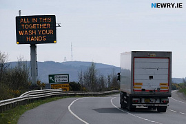 A Covid-19 sign on the A1 outside Newry. Photograph: Columba O'Hare/ Newry.ie