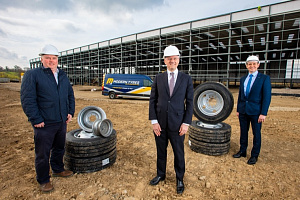 Rory Byrne, Director of Modern Tyres with Kevin Holland, CEO, Invest NI and James McKee, Financial Director, Modern Tyres.