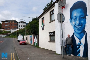 Emmanuel Mc Evoy pictured beside the mural of Noah Donohue on his gable on the junction of Catherine Street/ Canal Street, Newry. Conor McGinley and Yella G of Pigment Space created the mural to remember schoolboy Noah who disappeared in Belfast in June, his body found a week later in a storm drain. Photograph: Columba O'Hare/ Newry.ie