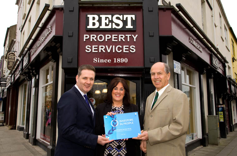 Best Property Services Office manager Edwina Flynn, with Eddie Salmon, Investors in People Practitioner Manager for IIP and Managing Director Garry Best with their new IIP plaque.