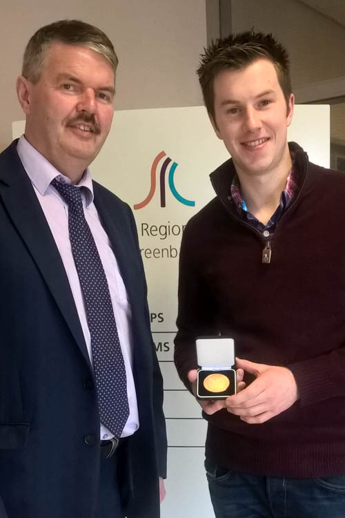 SRC Deputy Head of School Construction and Engineering John Muckian presenting Gary Doyle with his gold medal.