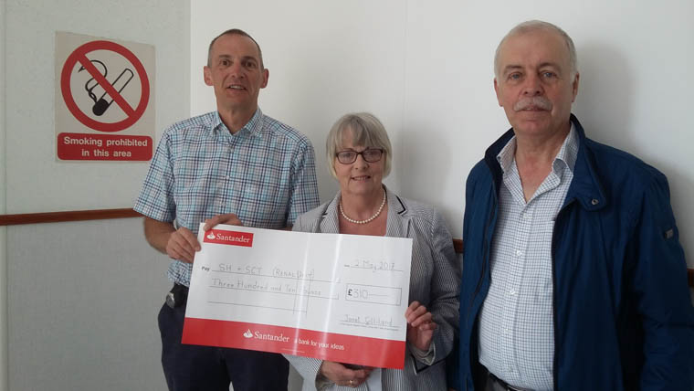 Dr John Harty Consultant Nephrologist with Janet and Gordon Gilliland who raised £310.00 for the Renal Unit at Daisy Hill Hospital.