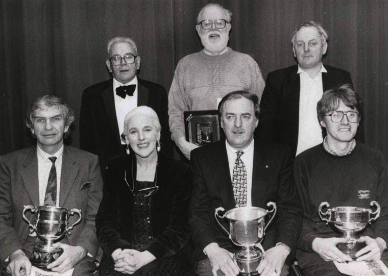 "Roma Tomelty, adjudicator, pictured with prize winners at Newry Drama Festival, 1993. Roma (first Director of Newry and Mourne Arts Centre) has also acted as adjudicator at Lislea Drama Festival, to which in 1983 she presented the ""Min Milligan Trophy"" in memory of her grandmother. Min Milligan was a talented actress of radio and stage fame, who was a household name in the 1940s and 1950s for her portrayal of 'Sarah' in the radio soap opera, The McCooeys."